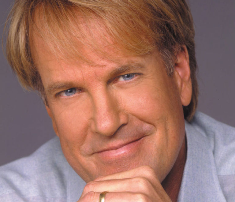 Life's Tough – but John Tesh is Tougher, conquering terminal cancer through a relentless process of focused purpose, grit, perseverance and faith, and using that to inspire through passion and intelligence!